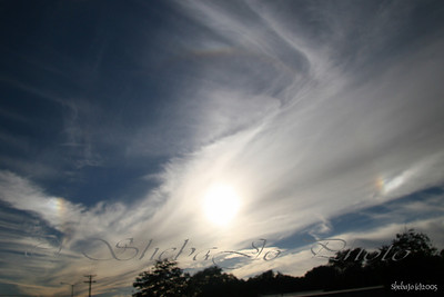 sundogs and fading sun halo. taken with CP filter
