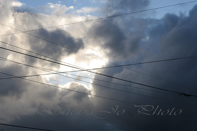 What were they thinking??? Who designs these utility lines? Clouds in the sky