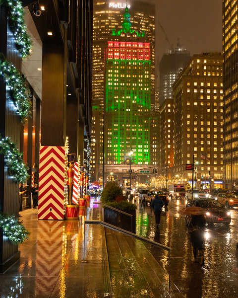 Helmsley Building and Park Avenue decorated for Christmas during a rain storm.