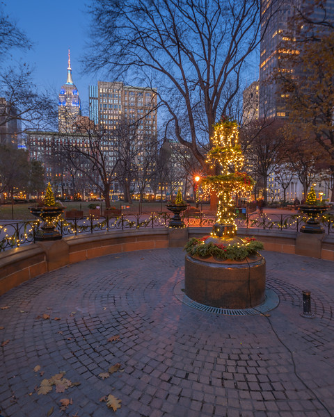 Madison Square Park fountain with the Empire State Building in late fall.