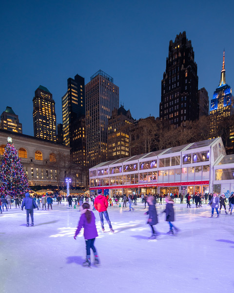 Bryant Park Ice Skating with the Christmas Tree and the Empire State Building.