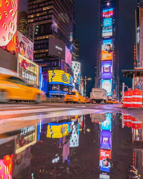 Times Square after the rain.  Passing taxis.