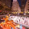 Ice skating rink at Rockefeller Center with the Prometheus sculpture in the foreground.