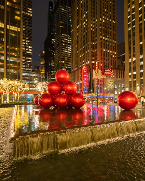 Radio City Music Hall, red ornament balls, and reflections early in the morning.