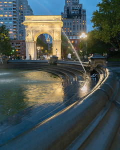 Washington Square Park, Fountain, Arch, and the Empire State Building in the rain
