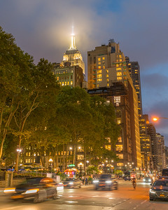 Empire State Building from 6th Avenue in the fog during the blue hour.