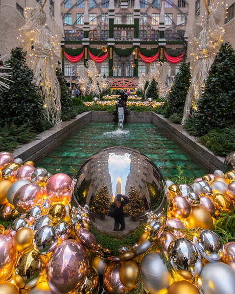 Reflective Ball in Channel Gardens in Rockefeller Center at Christmas time, early morning.