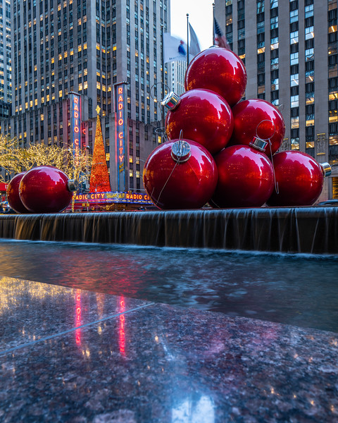 Radio City Music Hall, Large Red Ornaments, and Reflections in the granite ledge.