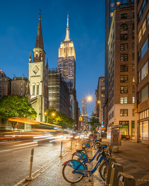 Empire State Building and Collegiate Church at the Blue Hour with CitiBikes and a Passing Bus