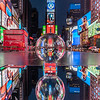 Times Square as seen through a crystal ball and its reflection in a mirror.