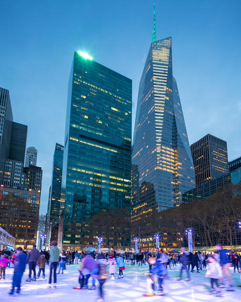 Ice Skating in Bryant Park with the Bank of America Tower in the distance.