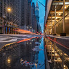 Reflection of the Chrysler Building and a Passing Taxi on Lexington Avenue during the Blue Hour