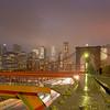 New York City Skyline seen from the Brooklyn Bridge during a rainstorm.