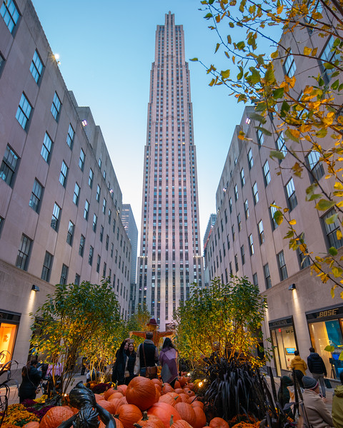 Rockefeller Center at Channel Gardens during halloween with morning light, with fall colors.