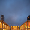 Lincoln Center during the blue hour with a taxi waiting out front.