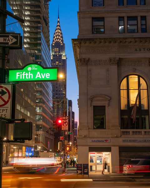 Fifth Avenue, Chrysler Building, and a speeding taxi early in the morning.
