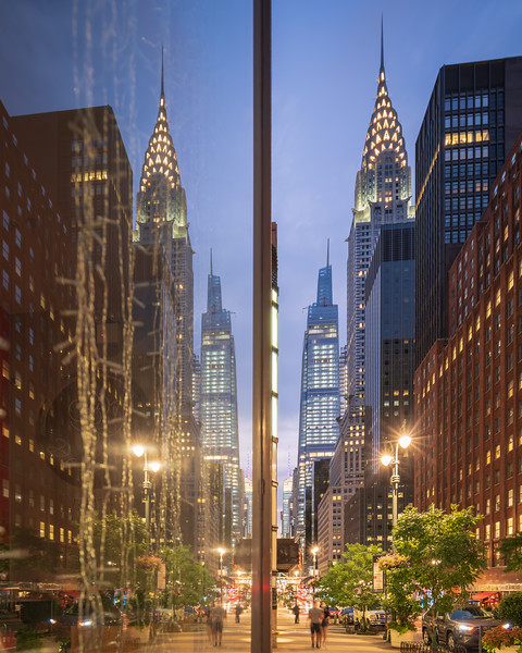 Reflections of the Chrysler Building and One Vanderbilt in a shop window on 42nd Street during the blue hour.