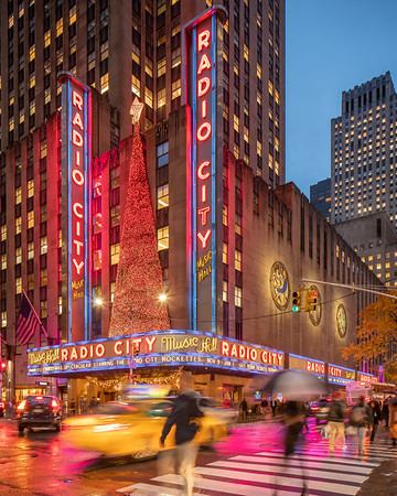 Radio City Music Hall in the rain during the Rockettes' Christmas Spectacular with a taxi.