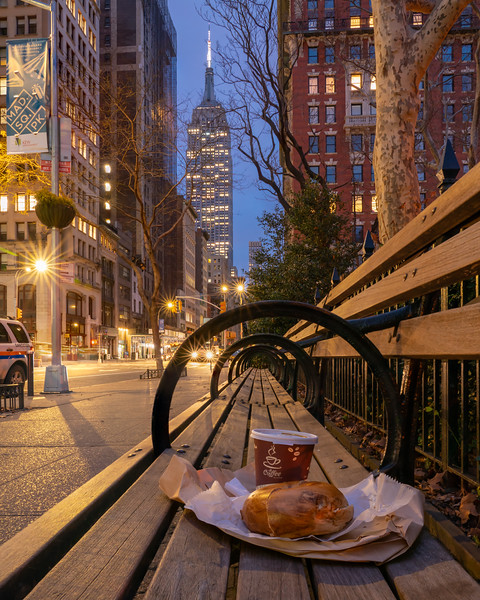 Coffee and a Bagel in Madison Square Park with a view of the Empire State Building.