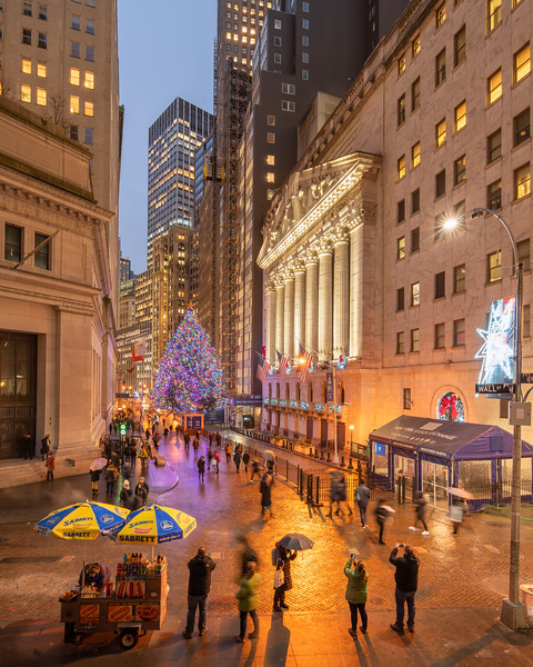 Wall Street, NYSE, and its Christmas Tree on a rainy evening.