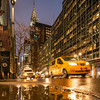 Chrysler Building on 42nd Street with a taxi after the rain.