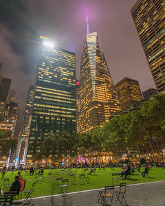 Bank of America Tower and Bryant Park in the foreground.  Blue hour in the fog.