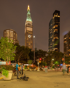 The Clock Tower at Madison Square Park with a street singer in the foreground.