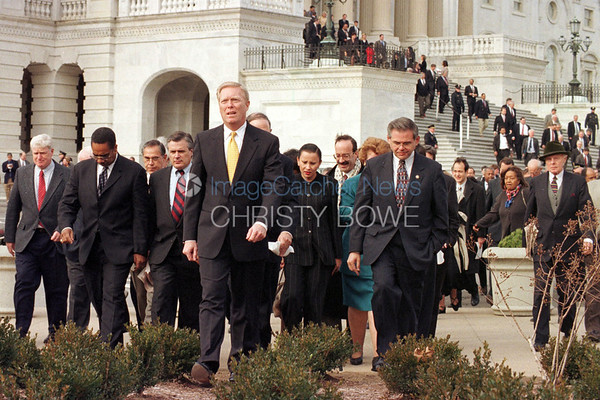 Members of Congress leave the Capitol as they approach reporters to deliver their verdict on the Impeachment of  President Bill Clinton.