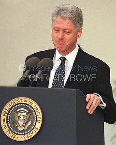 Standing in The Rose Garden of The White House , President Clinton responds to his verdict of not guilty by the U.S. Senate