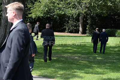 Presidents Obama and Clinton walk to the Oval Office.