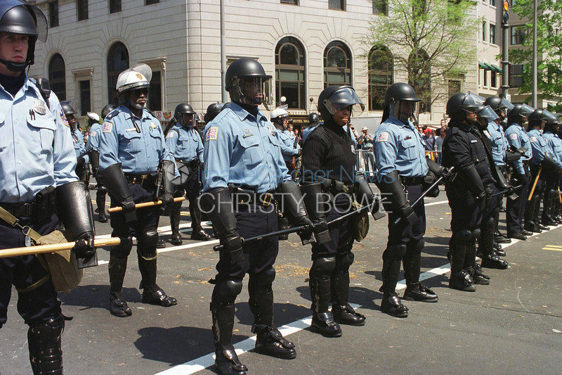 Police Offcers dressed in their riot gear face off demonstrators during the World Bank / IMF protesting activities.