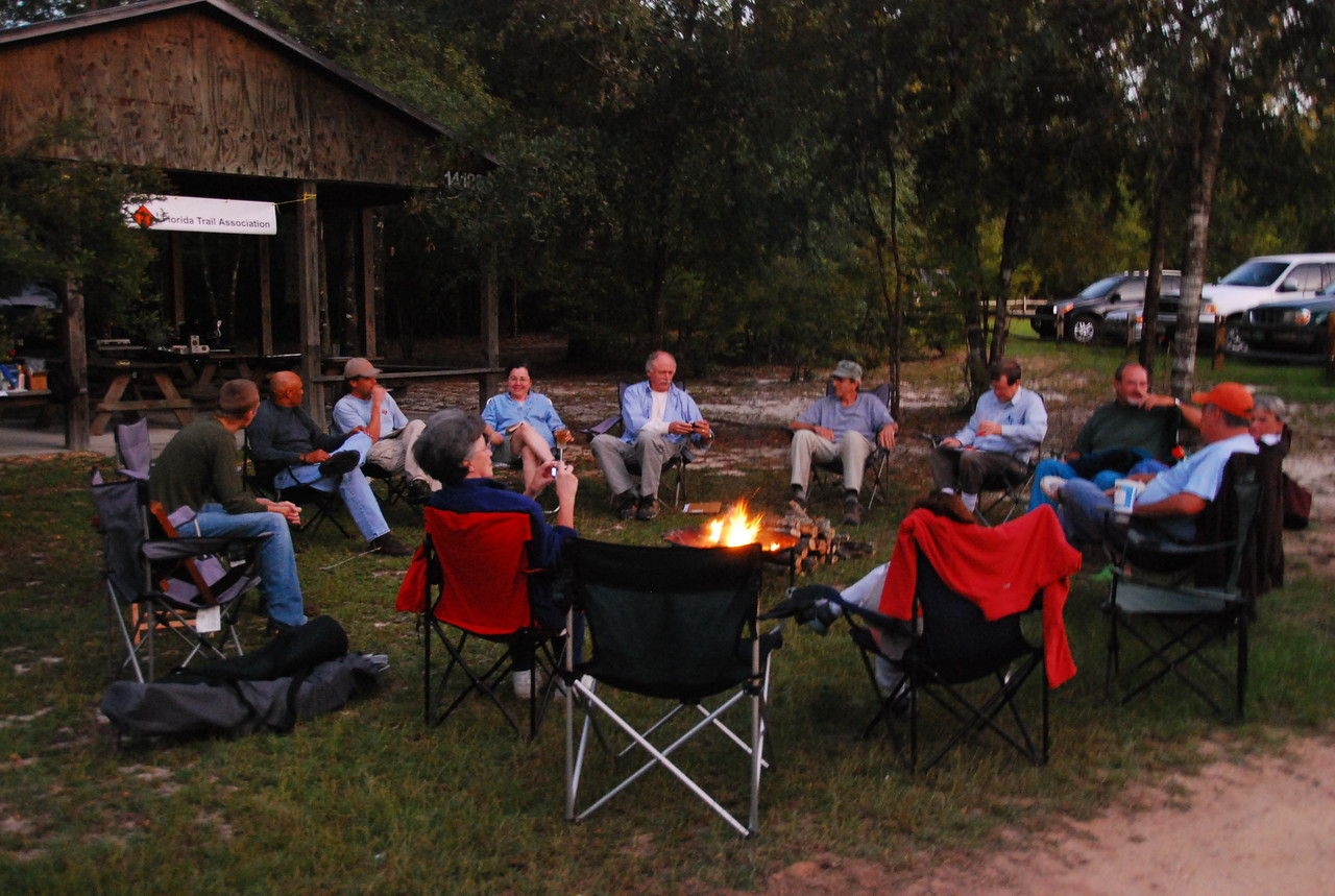 Gathering around the campfire<br /> PHOTO CREDIT: Megan Eno / Florida Trail Association
