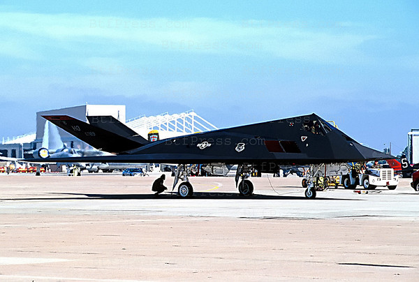 The Lockheed F-117 NightHawk is invisible to radar has revolutionized air warfarewas in demonstration in San Diego to the Miramar base in August 1999. It is a single-Seat Attack and defense suppression Aircraft withe two engines ( 10.800lb ). The dimensions, Span 43ft 4inches, Lenth 65ft 11inches, Heig 12ft 5inches,Wing Area 880sq.ft. the performance Speed , Mach 1.0, endurance(with inflight refueling) 12 hours. Armement: up to  5,500lb .laser-guided bombs,air to air missiles ( Photo Michel Boutefeu )