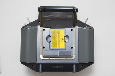 Rear view showing cover for optional external module and smaller access panels. Note rubber feet.