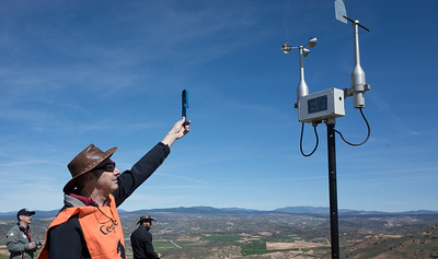 Mike Evans calibrates his wind meter