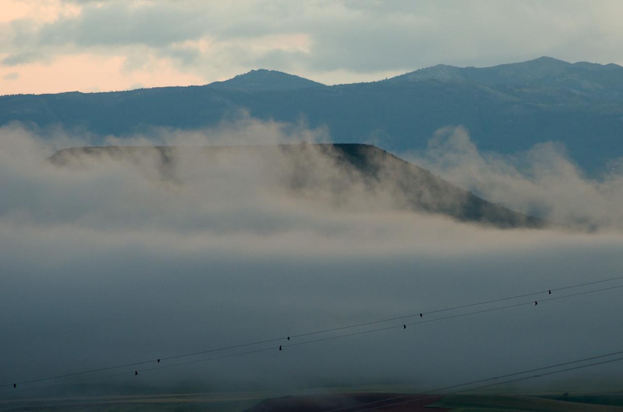 Early morning mist envelopes La Muela