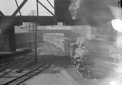 2016.010.FAC5.05271--cole 6x9-12pak neg--CB&Q--steam locomotive 4-4-2 2510 with mail train arriving at Union Station--Chicago IL--1919 0831