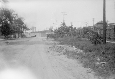 2016.010.FAC6.02808--cole 500 neg--CMStP&P--scene looking north with passenger train at Cicero and Montrose--Chicago IL--1928 0604