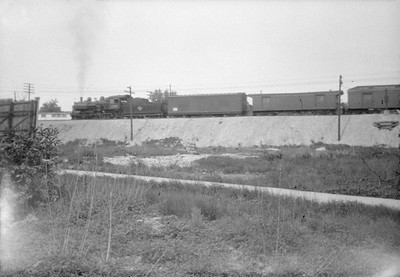 2016.010.FAC6.02809--cole 500 neg--CMStP&P--scene looking north with passenger train at Cicero and Montrose--Chicago IL--1928 0604