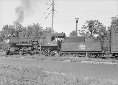 2016.010.FAC6.08213--cole 6x9-8pak neg--CMStP&P--steam locomotive 0-8-0 D1 1550 switching cars--Clinton IA--1952 0823