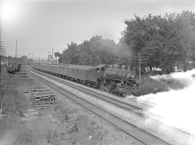2016.010.FAC1.02058--cole 3x4 neg--C&NW--steam locomotive 4-6-2 E 1587 on passenger train action--Wheaton IL--1921 0718