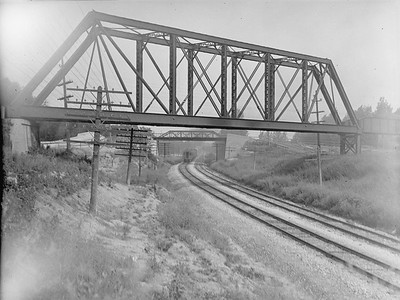 2016.010.FAC1.02056--cole 3x4 neg--C&NW--view of AE&C bridge over mainline--Wheaton IL--1921 0718