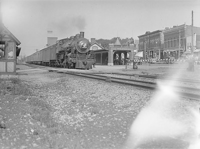 2016.010.FAC1.02057--cole 3x4 neg--C&NW--steam locomotive 4-6-2 E 1615 at station with passenger train--Wheaton IL--1921 0718