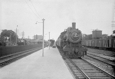 2016.010.FAC1.01856--cole 500 neg--C&NW--steam locomotive 4-4-2 D 1316 on passenger train--Geneva IL--1930 0614