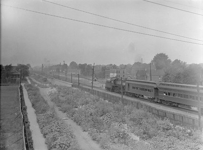 2016.010.FAC1.02090--cole 3x4 neg--C&NW--steam locomotive 4-6-0 R on passenger train action--Chicago IL (46th and Kinzie)--1921 0723