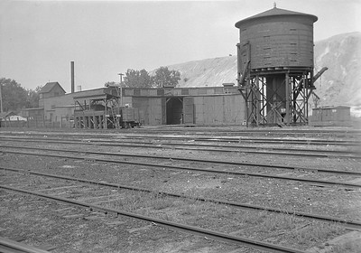 2016.010.FAC1.05674--cole 6x9-8pak neg--C&NW--roundhouse and water tank--Spring Valley IL--1930 0823