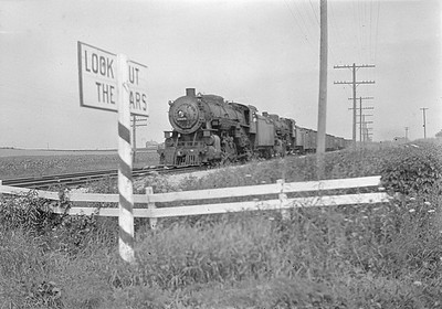 2016.010.FAC1.06415--cole 6x9-8pak neg--C&NW--steam locomotive 2-8-2 J 2524 2528 on freight train--near Geneva IL--1933 0714
