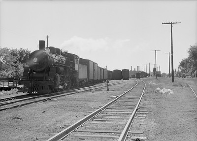 2016.010.FAC2.07374--cole 6x9-8pak neg--C&NW--steam locomotive 4-6-0 R-1 894 with cars in yard scene--Rochester MN--1950 0630