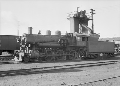 2016.010.FAC2.07362--cole 6x9-8pak neg--C&NW--steam locomotive 4-6-0 R-1 1113 taking coal at coal hoist--Winona MN--1950 0630