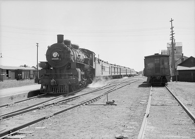 2016.010.FAC2.07378--cole 6x9-8pak neg--C&NW--steam locomotive 4-6-2 E 1548 on passenger train in yard scene--Waseca MN--1950 0630
